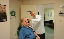 Doctor performing hearing test iData
