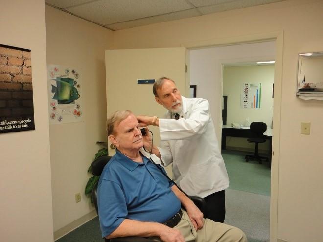 Doctor performing hearing test iData