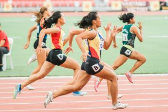 Women Running On Track Field iData